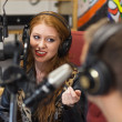 Attractive happy radio host interviewing a guest — Stock Photo #36170301