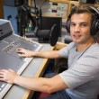 Stock Photo: Handsome smiling radio host moderating