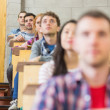 Close-up of young students sitting in classroom — Stockfoto