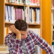 Handsome tired student studying his books — Stock Photo