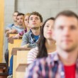 Close-up of young students sitting in classroom — Foto de Stock