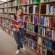 Pretty smiling student holding notebooks — Stockfoto #36171417