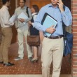 Attractive mature student phoning with his smartphone — Stock Photo