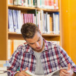 Stock Photo: Handsome concentrating student studying his books