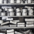 Shelf full of pots — Stock Photo #36171669
