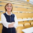 Elegant teacher standing in the lecture hall — Stock fotografie