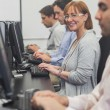 Female mature student sitting in computer class — Stock Photo