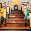 Rlegant teacher with students sitting at the lecture hall — Stock Photo