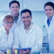 Smiling scientists with tablet PC in the laboratory — Stock Photo #36172455