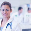 Close-up portrait of confident female doctor at medical office — Stock Photo #36172531