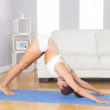 Fit slim woman practicing yoga pose for stretching her body — Stock Photo