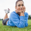 Pretty young woman lying on the grass — Stock Photo
