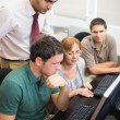 Teacher and mature students in computer room — Stock Photo #36173469