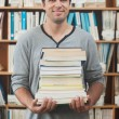 Stock Photo: Adult student posing holding stack of books