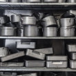 Stock Photo: Shelf full of baking tins