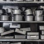 Shelf full of baking tins — Stock Photo #36173575