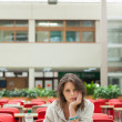 Stock Photo: Gloomy student in cafeteriwith food tray