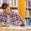 Handsome focused student studying his books — Stock Photo #36174231