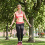 Blonde sporty woman skipping — Стоковое фото