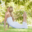 Stock Photo: Attractive fit womstretching