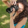 Stock Photo: High angle view of brunette young womtaking picture