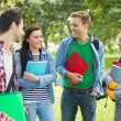 Cheerful young college students in park — Stock Photo