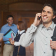 Happy mature student phoning with his smartphone — Stock Photo #36175075