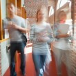 Students walking through hallway toward camera — Stock Photo