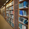 Row of bookshelves filled with books — Stock Photo #36175903