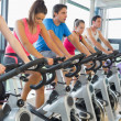 Stok fotoğraf: Determined people working out at spinning class
