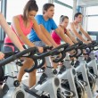 Stock Photo: Determined people working out at spinning class