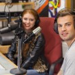Attractive cheerful radio host interviewing a guest — Stock Photo #36176005