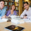 Mature students studying together in the library — Stock Photo #36176657