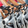 Stock Photo: Mid section of people working out at spinning class