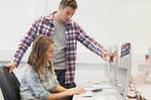 Two focused students working on computer — Stock Photo