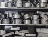 Shelf full of pans — Stock Photo