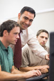 Teacher and mature student in computer room — Stock Photo