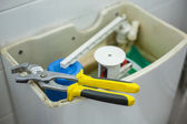 Close up of pliers lying on toilet — Stock Photo