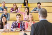 Elegant teacher with students at the lecture hall — Stock Photo