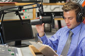 Well dressed focused radio host moderating — Stock Photo