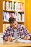 Handsome concentrating student studying his books — Stock Photo