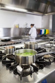 Several pots cooking on hotplate — Stock Photo