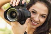 Gorgeous calm woman holding her camera — Stock Photo
