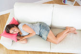 Lovely casual woman napping on her couch — Stock Photo