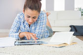 Pretty young student using her tablet for doing homework — Stock Photo