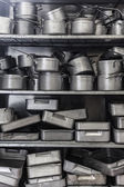 Shelf full of baking tins — Stock Photo