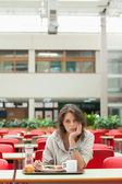 Gloomy student in the cafeteria with food tray — Stock Photo