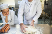 Head chef kneading dough — Stock Photo