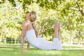 Attractive fit woman stretching — Stock Photo