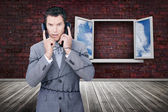 Serious businessman wrapped in cables phoning — Stockfoto
